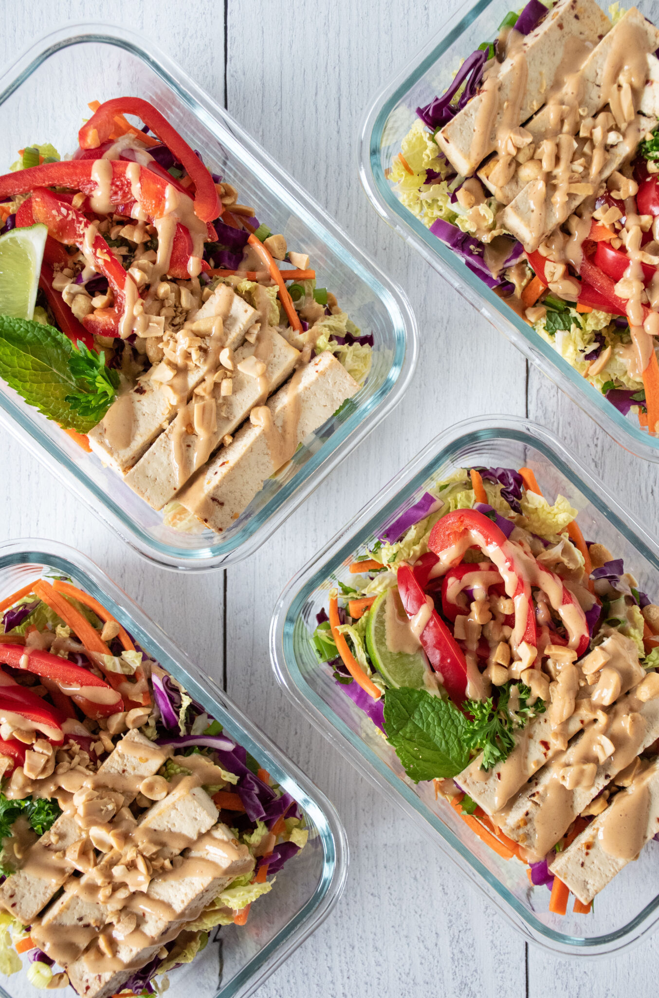 Overhead picture of Thai salad in meal prep containers.