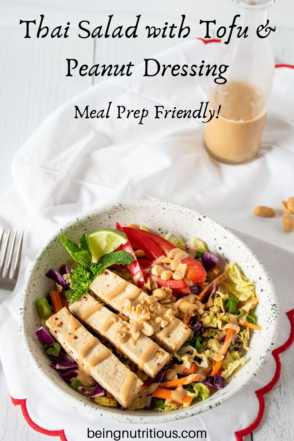 Bowl of Thai salad. Text overlay: Thai Salad with Tofu and Peanut Dressing; Meal Prep Friendly.
