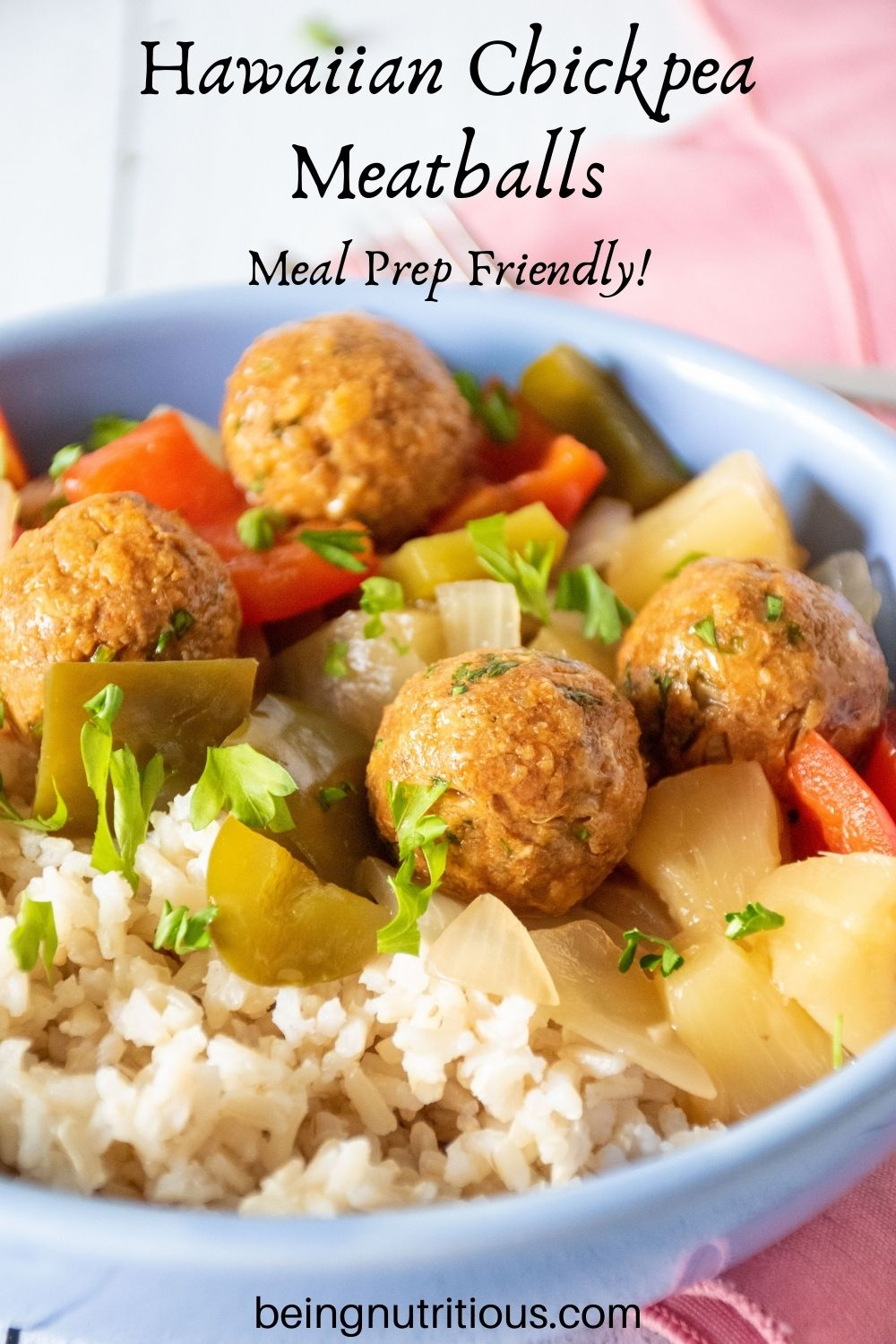 Bowl with rice, meatballs, and onions and bell peppers. Text overlay: Hawaiian Meatballs; Meal prep friendly!
