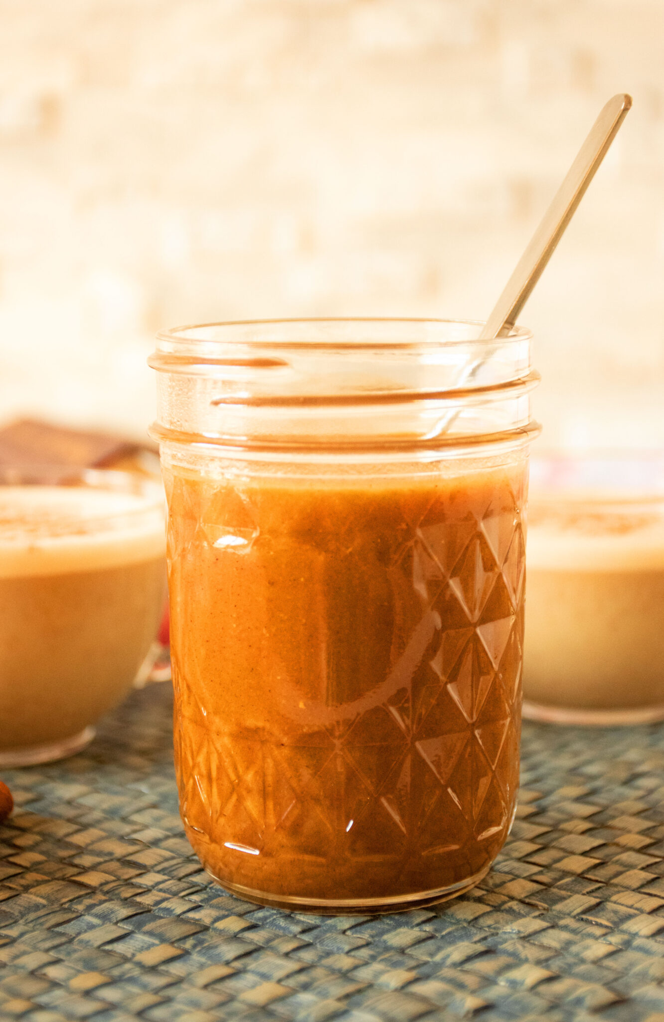 Glass jar with pumpkin spice syrup in it.