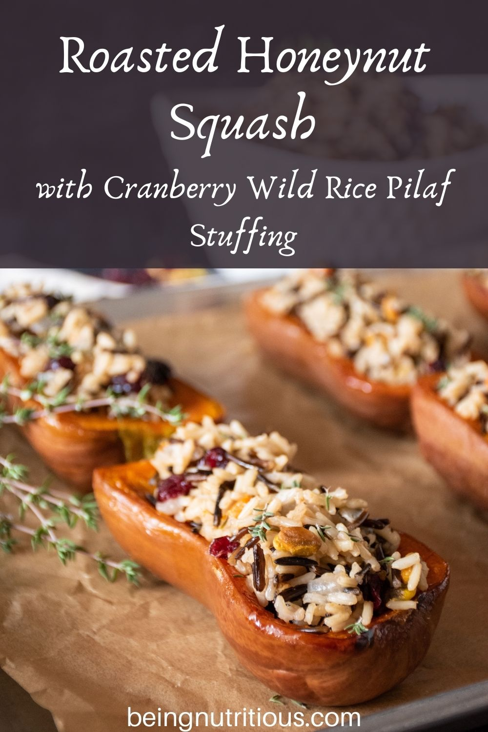 Stuffed honeynut squash halves on a baking pan. Text overlay: Roasted Honeynut Squash with Cranberry Wild Rice Pilaf Stuffing.