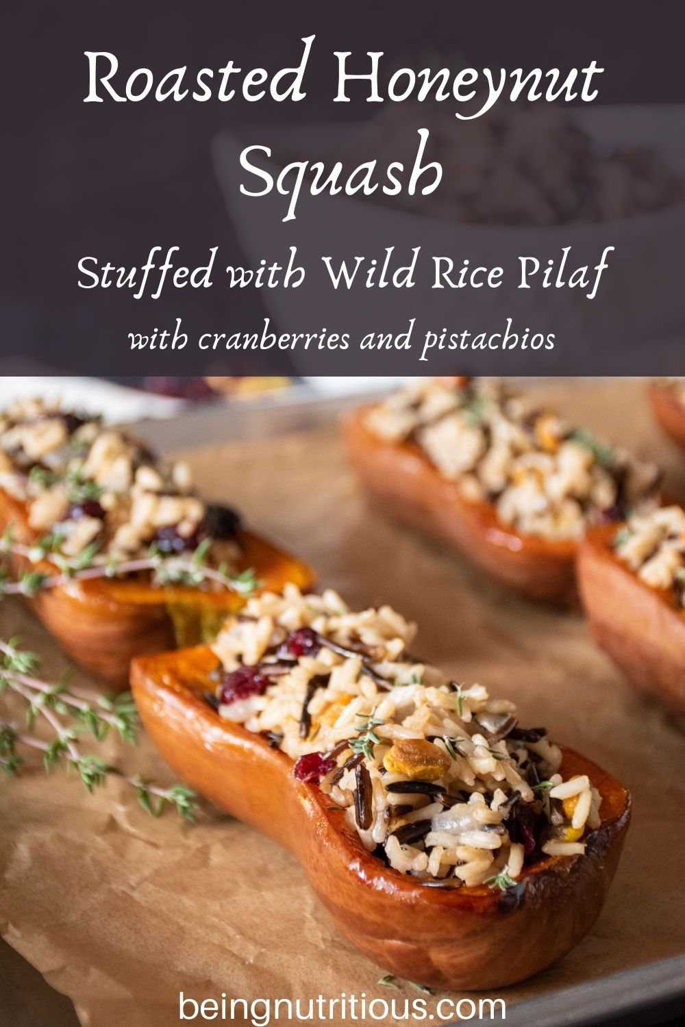 Stuffed honeynut squash halves on a baking pan. Text overlay: Roasted Honeynut Squash Stuffed with Wild Rice Pilaf, with cranberries and pistachios.